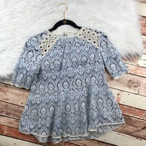 Anthropologie HD in Paris blue laced swing blouse